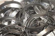 A pile of clock spring components