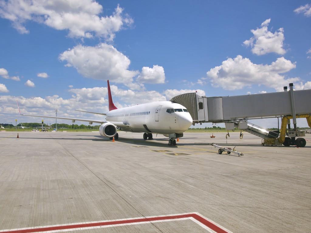 Passenger jet plane standing at the terminal gate