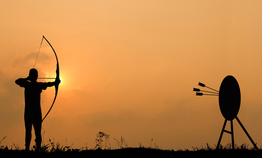 Silhouette archery shoots a bow at the target