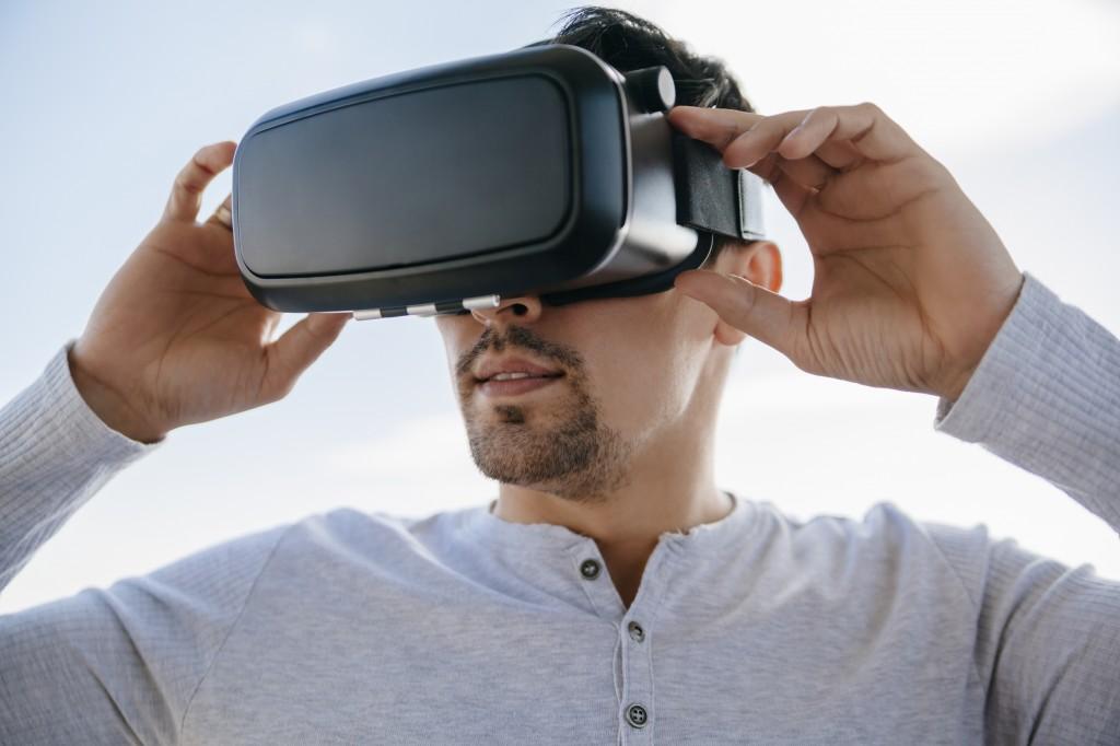 Young Man Using Virtual Glasses
