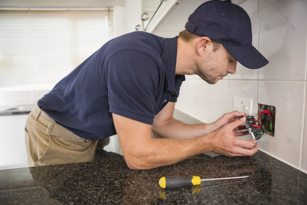 electrician in kitchen iStock_000053918902_Medium