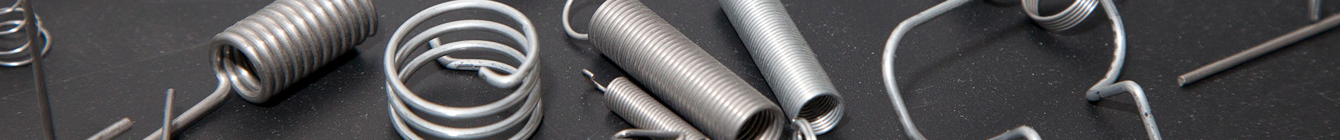 selection of springs on a grey background in a banner image
