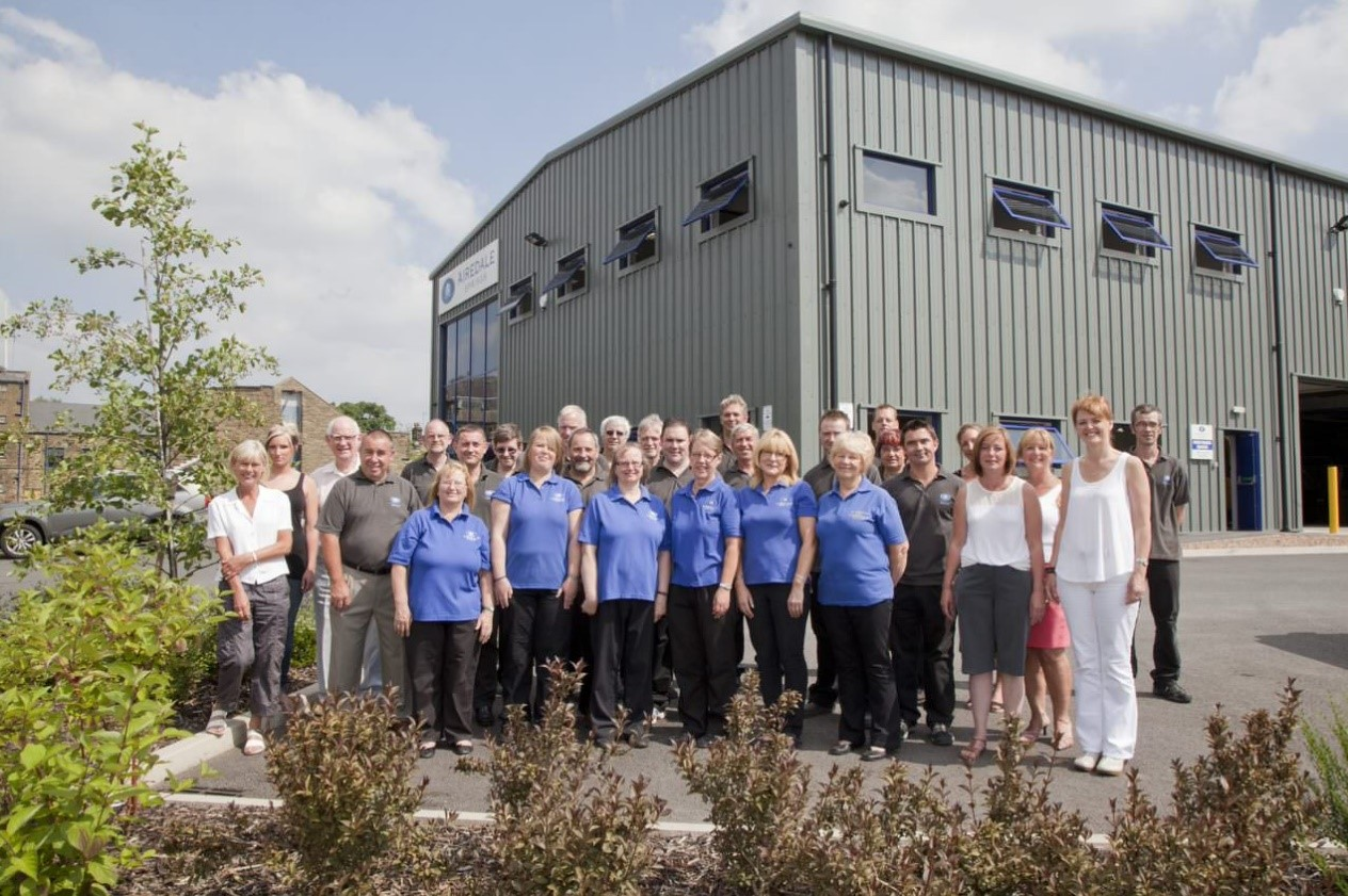 The airedale team stood together outside the manufacturing facility