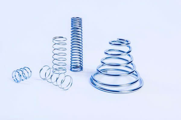 compression spring arrangement including conical compression spring