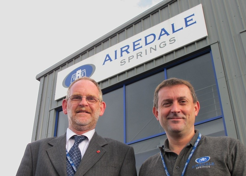 Airedale springs chairman and colleague stood outside manufacturing facility