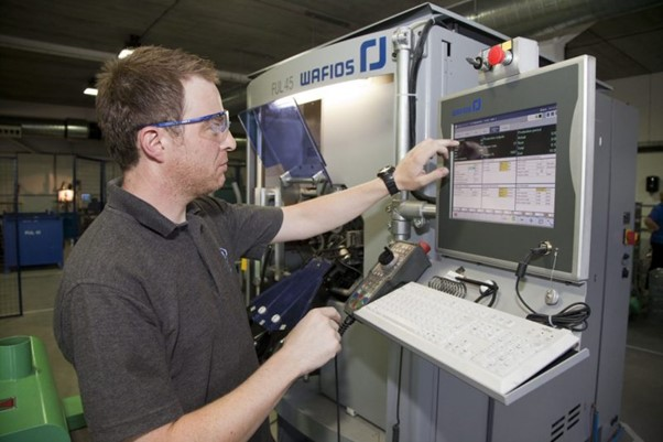 airedale springs employee using machine