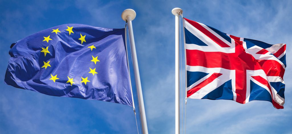 Brexit concept with flags over blue sky