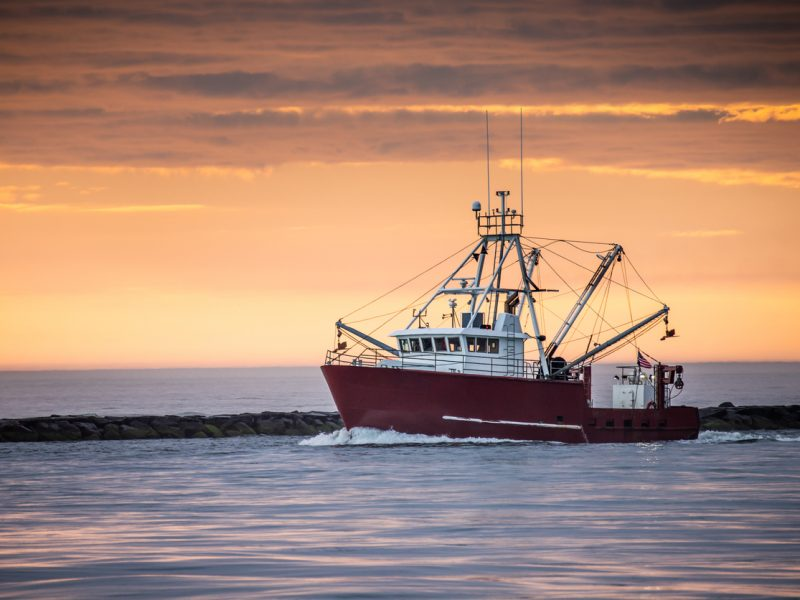Fishing boat returns to port after a long night - at Barnegat Inlet