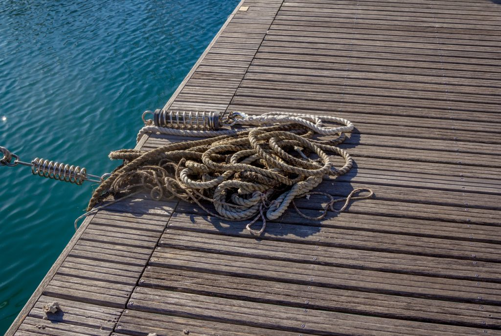 Mooring and seafaring ropes for boat anchoring on wooden ferry deck