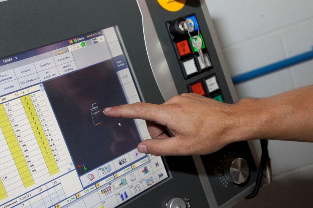 Airedale Springs 123insight system intergration. Hand operating a piece of software
